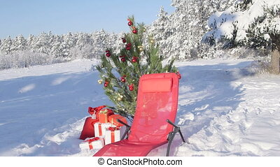 Gift bag under Christmas tree in snow covered winter forest