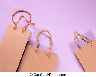 Gift bags on pink cardboard background - Craft gift bags ...