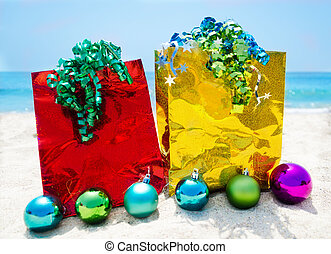 Gift bags with Christmas balls - holiday concept