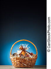 gift basket on blue background with copy-space