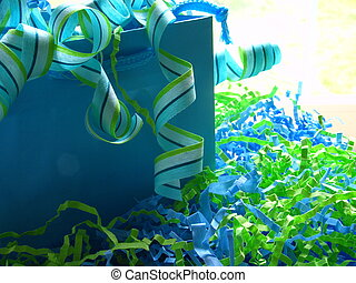 Gift - blue gift bag with striped ribbon spilling out and...