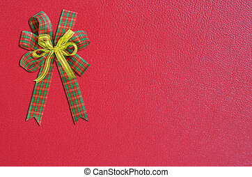 Gift bow on red background