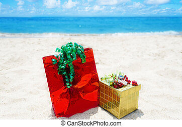 Gift box and bag on the beach - holiday concept