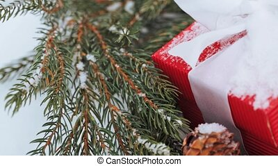gift box and fir wreath with cones on snow - holidays,...