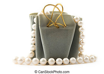 Gift box and pearl isolated on white