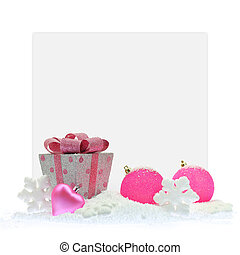 Gift box and pink Christmas ornaments in front of a paper card