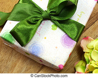 gift box close up on wooden background