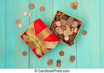 Gift box full of coins