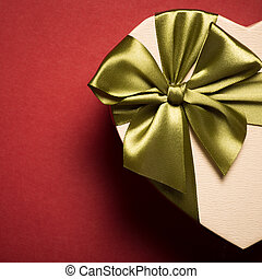 Gift Box Heart With Green Bow On Red Background. Top View.