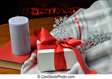 Gift box in front of fireplace