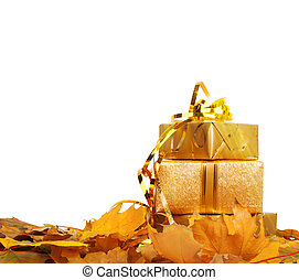 Gift box in gold wrapping paper with autumn leaves on white isolated glowing background