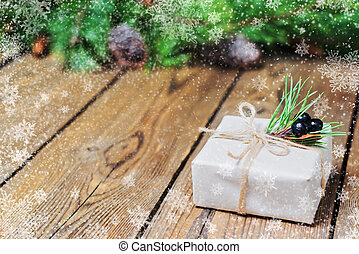 Gift box in retro style on background of spruce