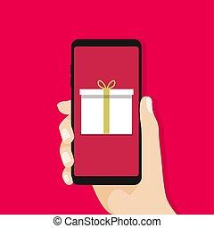 Gift box in smartphone screen. Hand hold smartphone.
