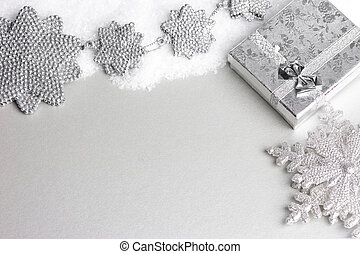 gift box in snow with snowflake