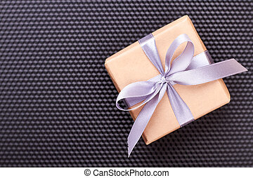 Gift box on black background.
