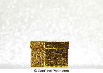 Gift box on glitter silver background