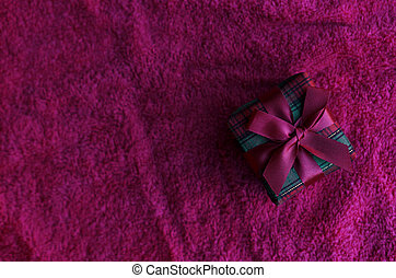 Gift box on red carpet backgrounds above for chirstmas themes concept