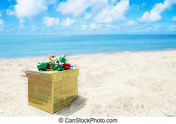 Gift box on the beach - holiday concept