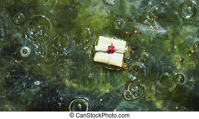 Gift box on the water