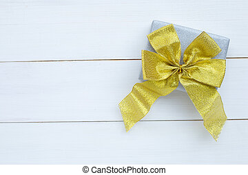 Gift box on white wooden background.