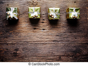 Gift box on wooden background