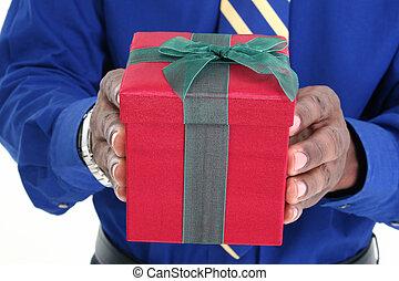 Gift Box - African American man giving velvet gift box...