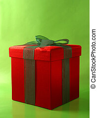 Gift Box - A red gift box with a green bow on a green...
