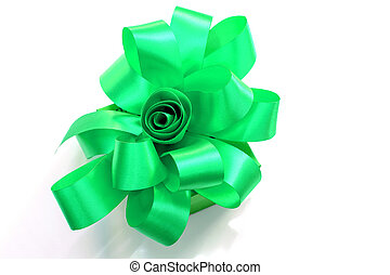 Gift box tied with a green ribbon bow.