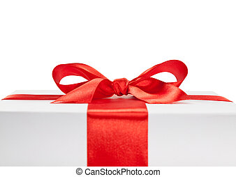 Gift box - white gift box with red ribbon bow, close up view