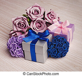 Gift Box with a bouquet of flowers on a wooden background