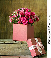 gift box with a bouquet of roses