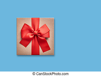 Gift box with a bow on a blue.