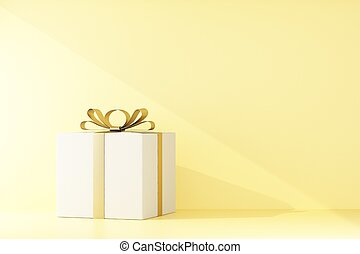 gift box with a gold bow on yellow background