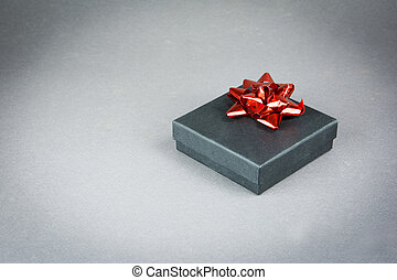 Gift box with a red ribbon
