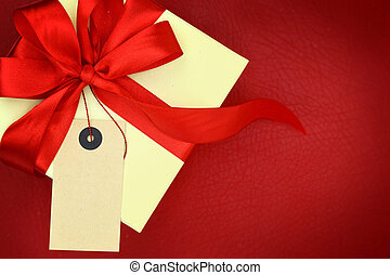 Gift box with blank tag on red background