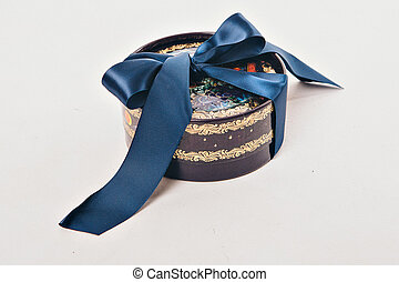 gift box with blue bow on white background