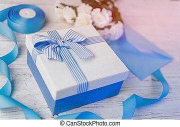 Gift box with blue ribbon and bow. Christmas presents in decorative boxes