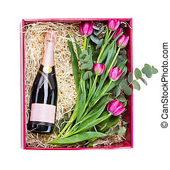 Gift box with bottle of champagne and tulips