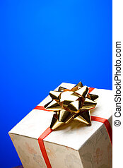 Gift box with bow on a blue background
