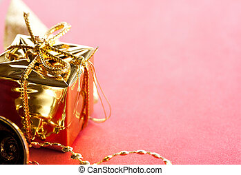 Gift box with bow on a red background
