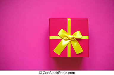 gift box with bow on pink background