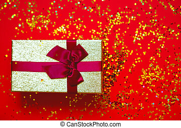 gift box with bow on red-gold background