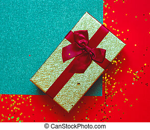 gift box with bow on red-green background