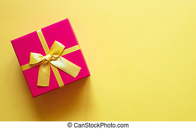 gift box with bow on yellow background