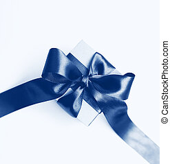 Gift box with brown bow on a white background. Classic blue toning trend 2020 year color