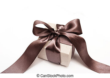 Gift box with brown bow on a white background