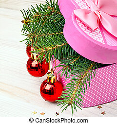 Gift box with christmas baubles and pinetree