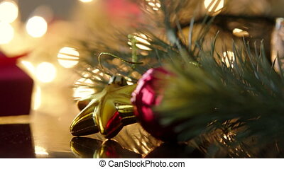 Gift box with christmas decoration and lights boken on the background