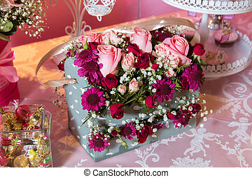 Gift box with colorful roses. Four-cornered birthday flower bouquet. Bouquets of paper flowers in a cardboard square boxes