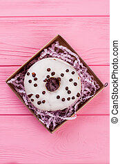 Gift box with donut, top view.